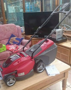 Susan's new mower. A coffee table, TV and sofa in the shed? There's posh.